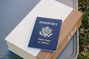 A passport with suitcase.
