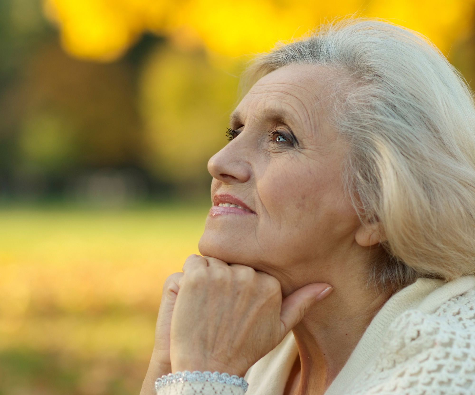 A retired woman thinking about whether she is ready to downsize