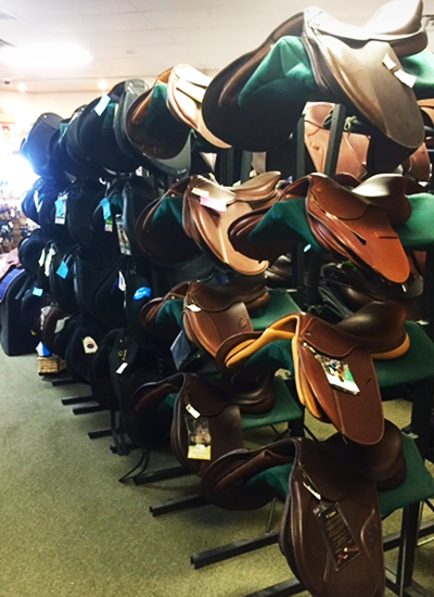 An assortment of leather saddles.