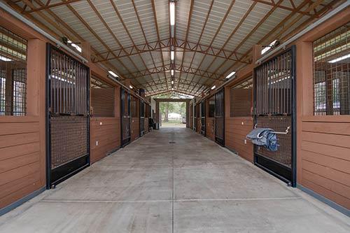 The interior of a horse barn.