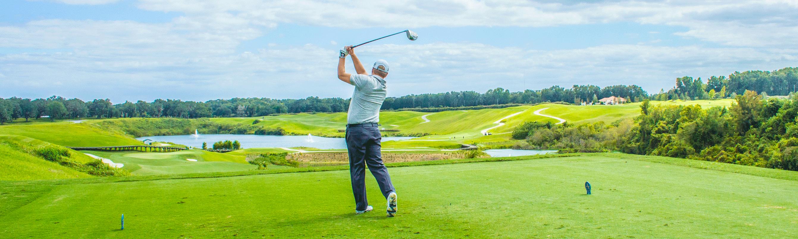 A man hitting a golf ball