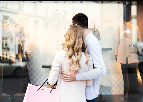 A man and a woman window shopping.