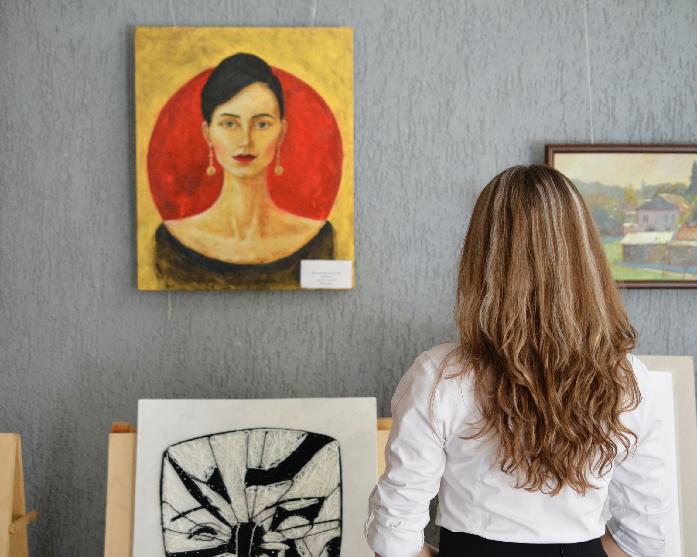 A woman viewing art in a gallery