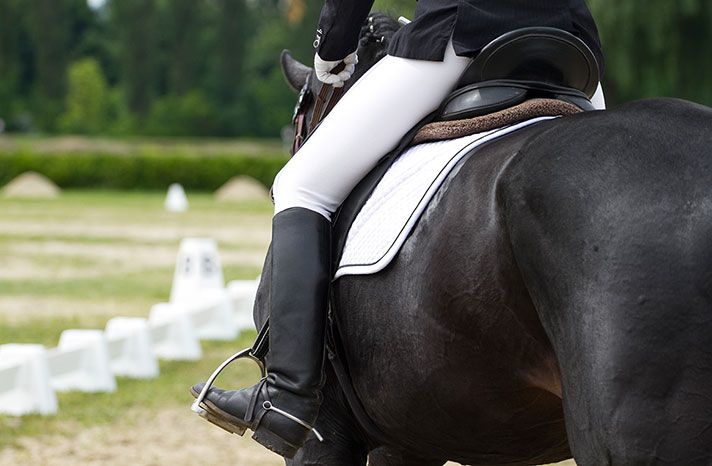 A competitor at a hunter jumper event.