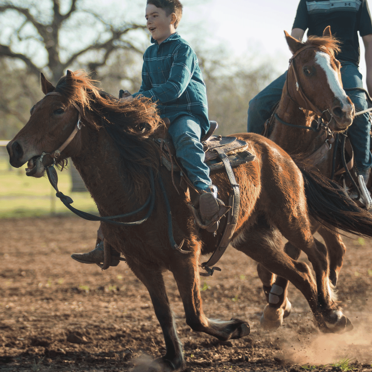A boy on a western saddled horse