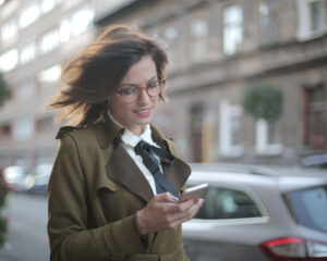 A woman checking a phone app.