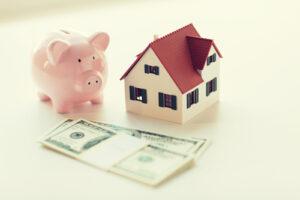 A piggy bank, money, and house.