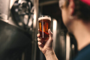 A man holding a glass of beer
