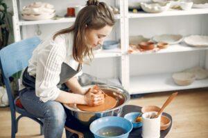 A woman using a potter's wheel.
