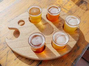 Glasses of beer in a palette shaped holder.