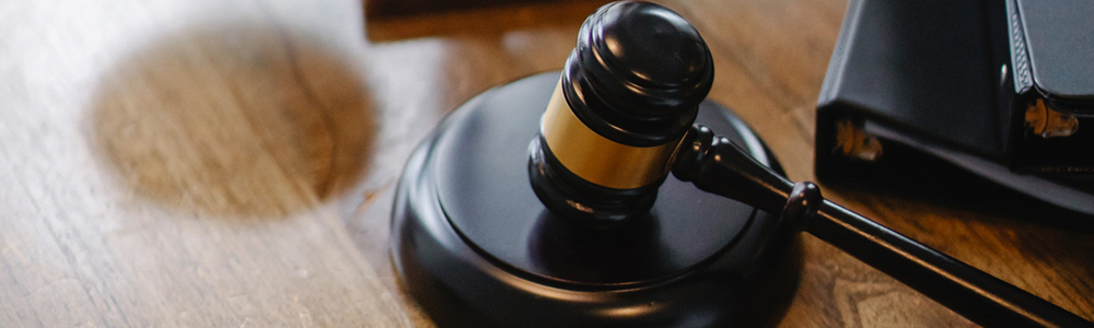 A judge's gavel in a courtroom