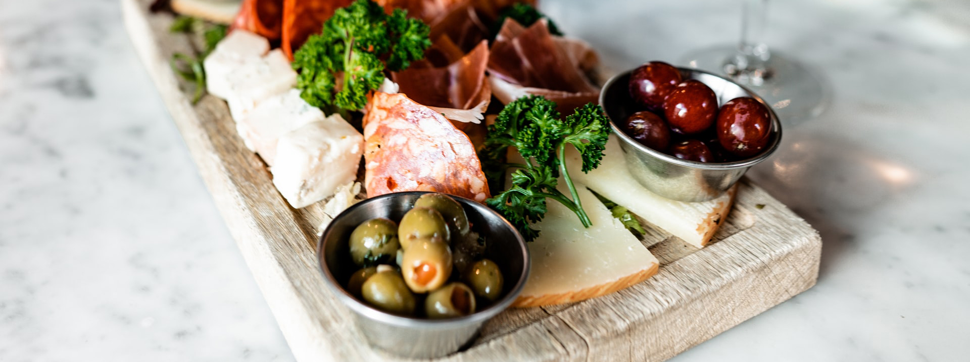 A cutting board covered with charcuterie selections.