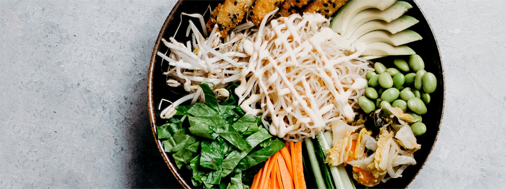 A bowl of fresh Asian ingredients.