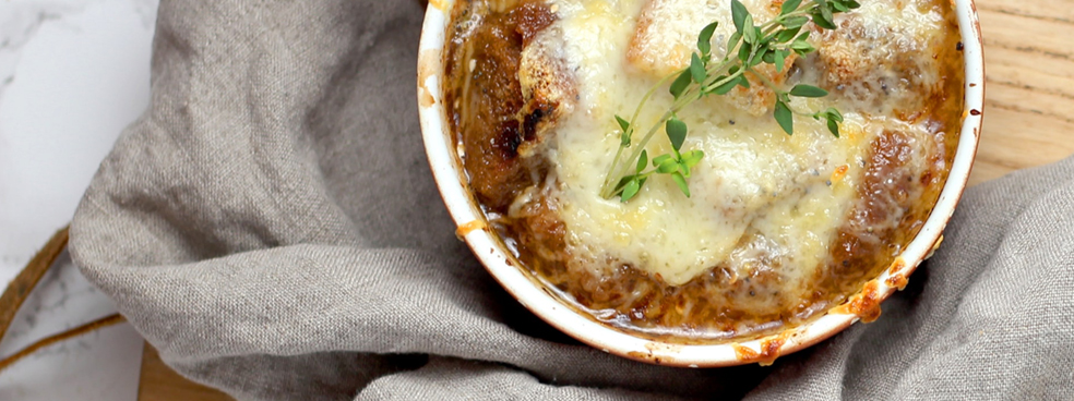 French onion soup with melted cheese on top.
