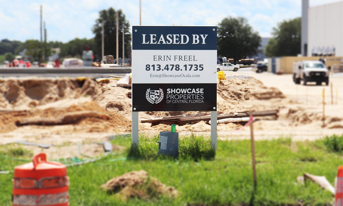 """A sign reading """"Leased by Erin Freel, Showcase Properties"""" is seen in front of the new construction."""
