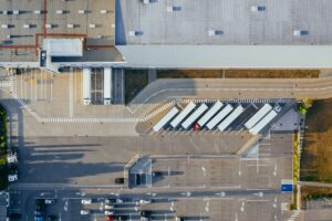 Aerial view of warehouse with trailers out front waiting for merchandise.