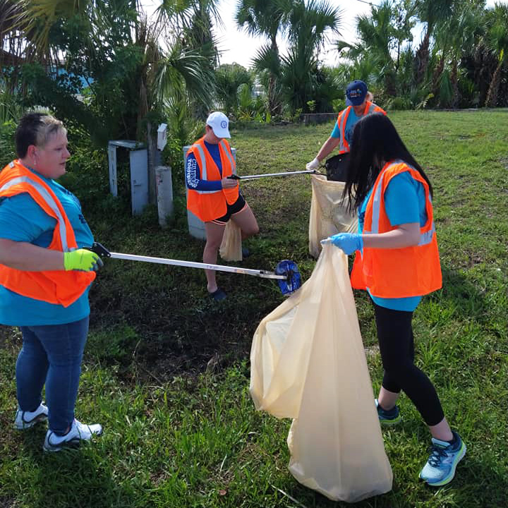 A group of volunteers picking up litter.