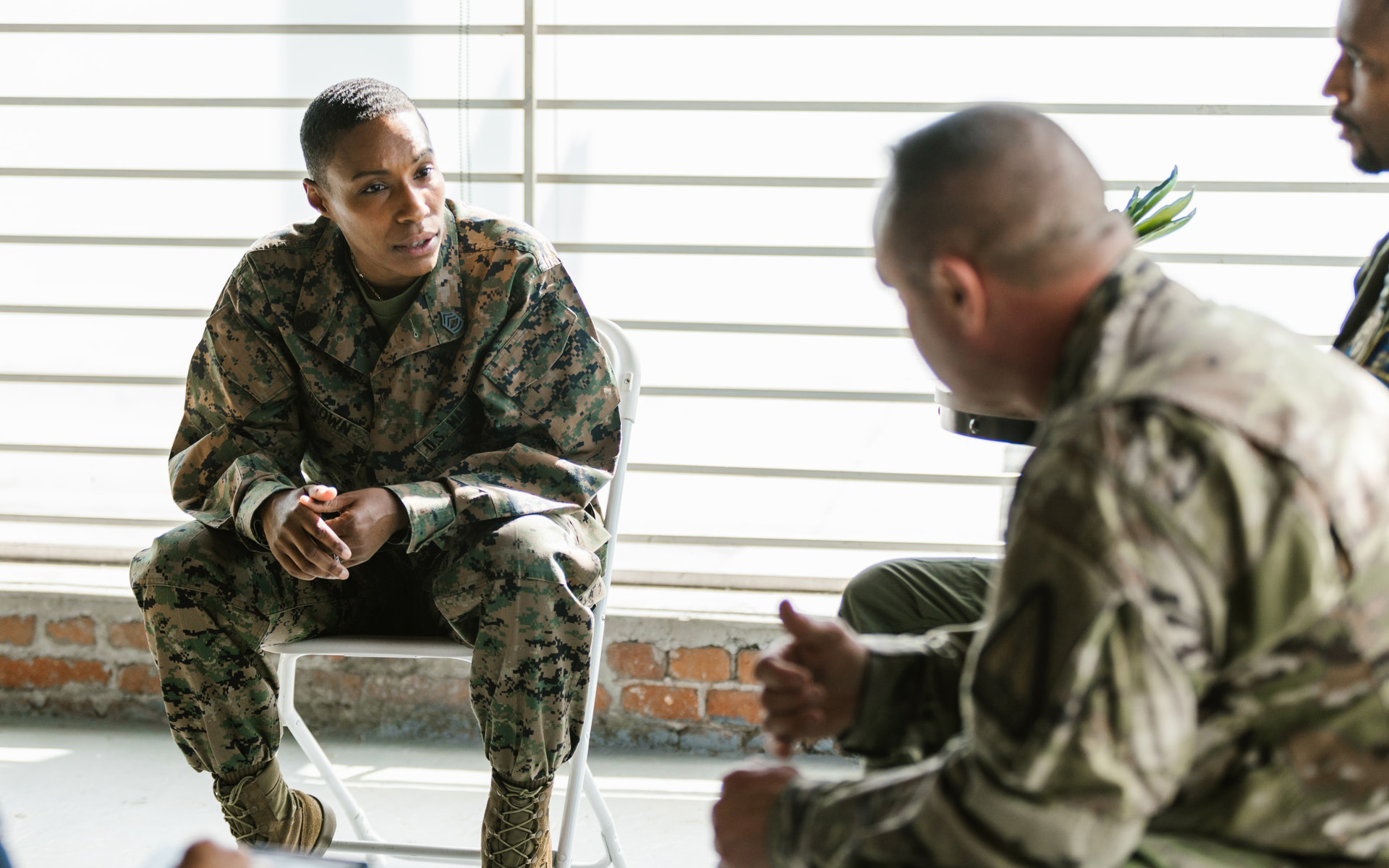 Military personnel having a discussion.