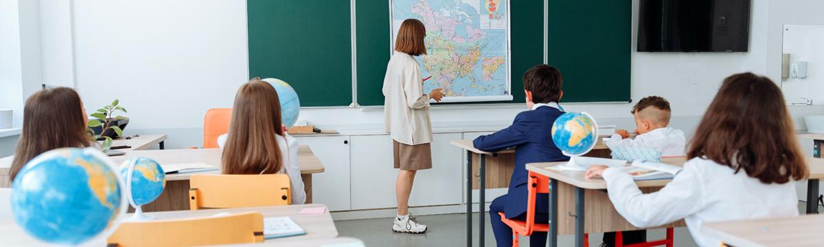 A teacher teaching a class of students.